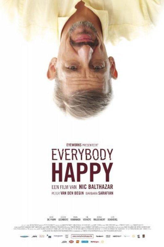 Everybody Happy. Een man van middelbare leeftijd met een ringbaardje en een geel overhemd staat ondersteboven afgebeeld.