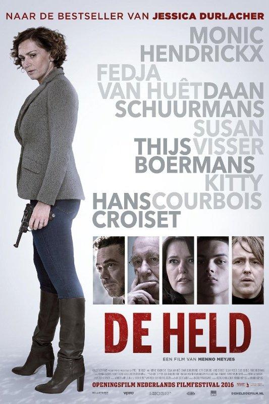 De Held: Een vrouw staat met een pistool in haar hand en kijkt onheilspellend naar beneden.