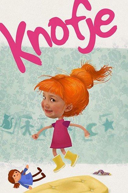 Knofje. Een klein roodharig meisje springt met haar pop op een matras.